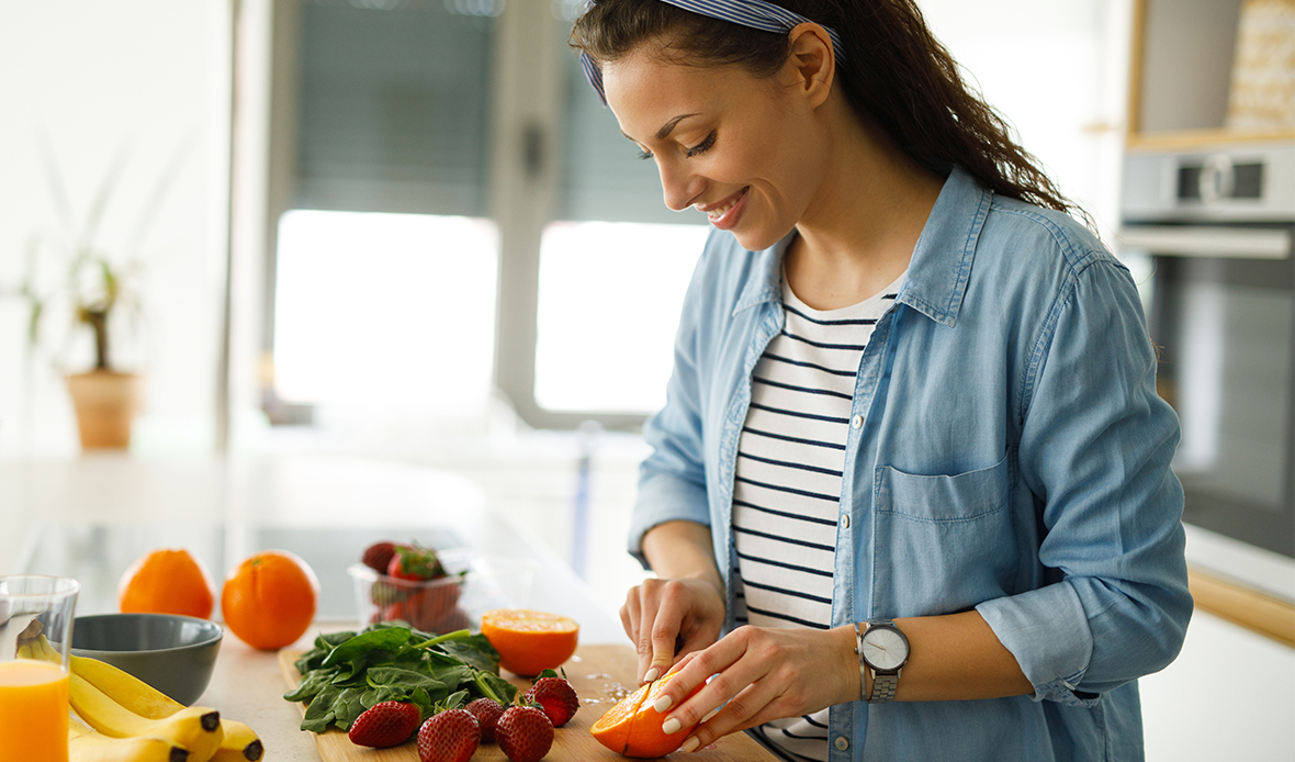 woman in kitchen shopping vegetables
