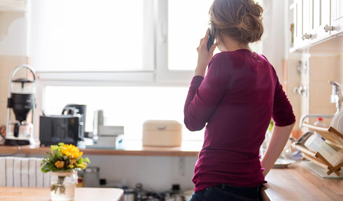 Women purple shirt on phone