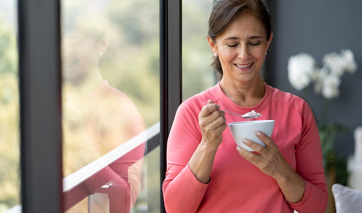 women smiling eating breakfast