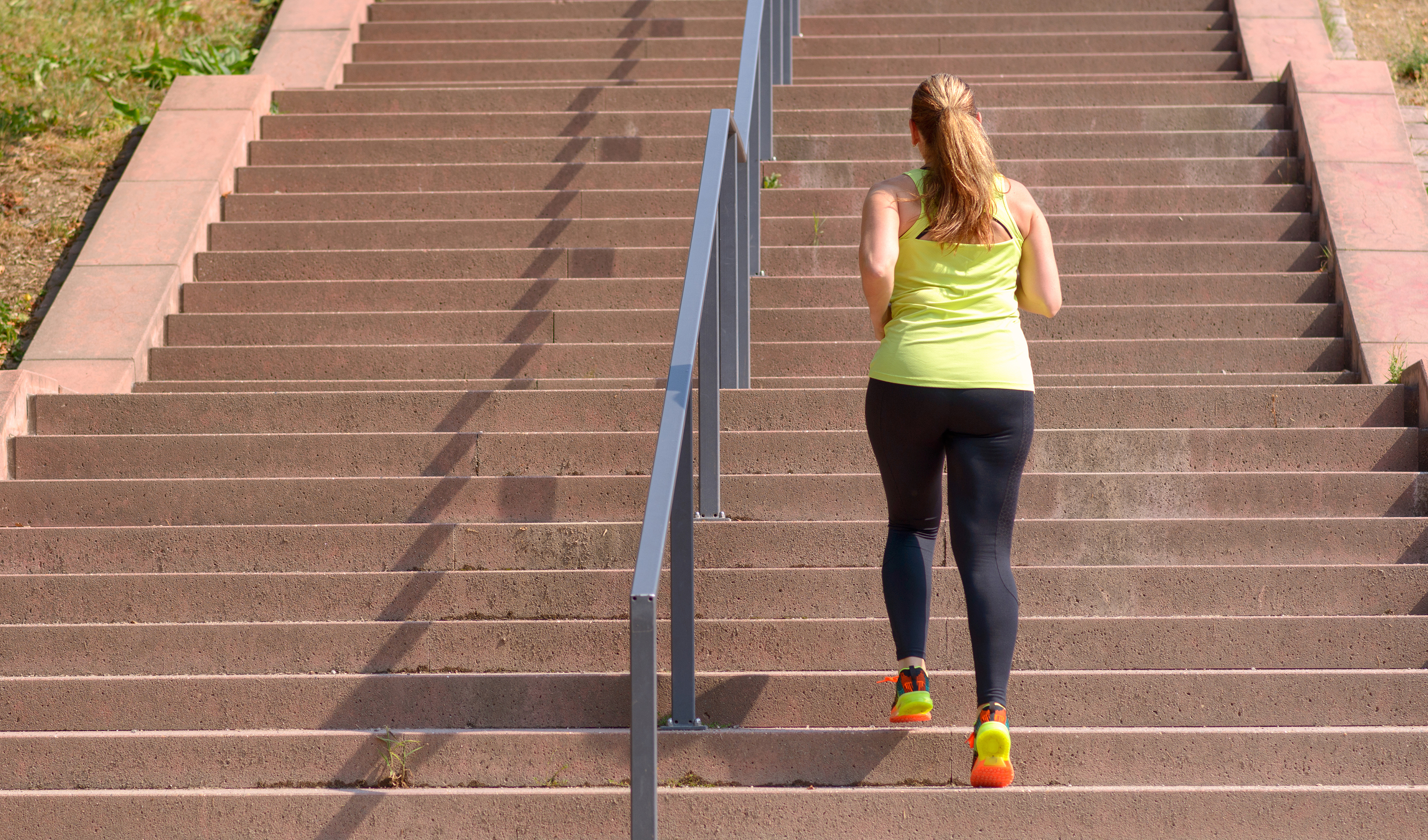 Women running up stairs outside